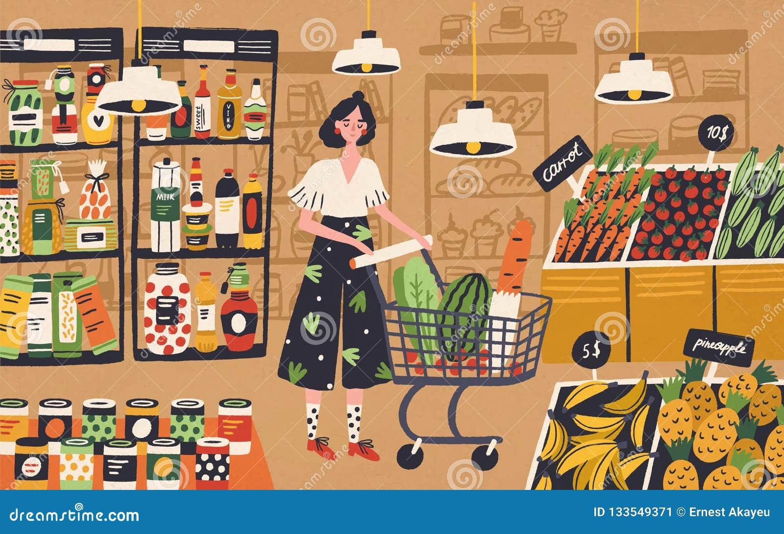有手推车选择和买的产品的逗人喜爱的年轻女人在杂货店 购买食物的女孩在超级市场