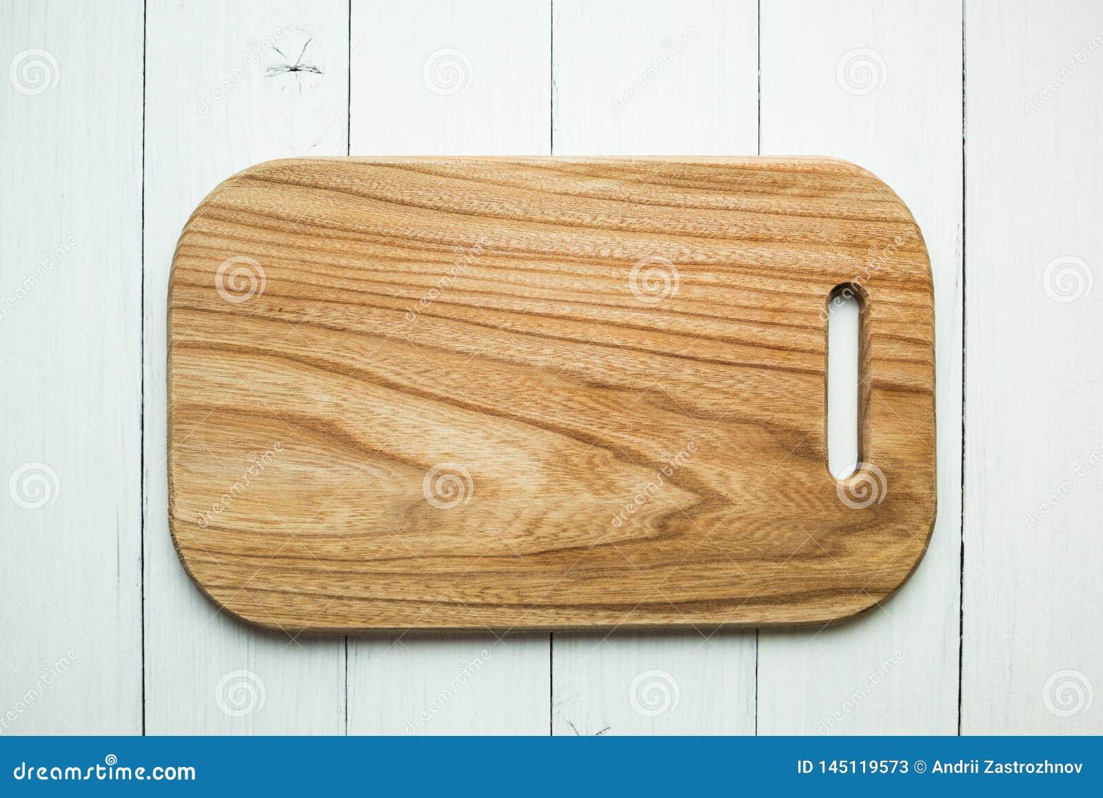 有木纹理的一个空的木切板在白色桌背景 r