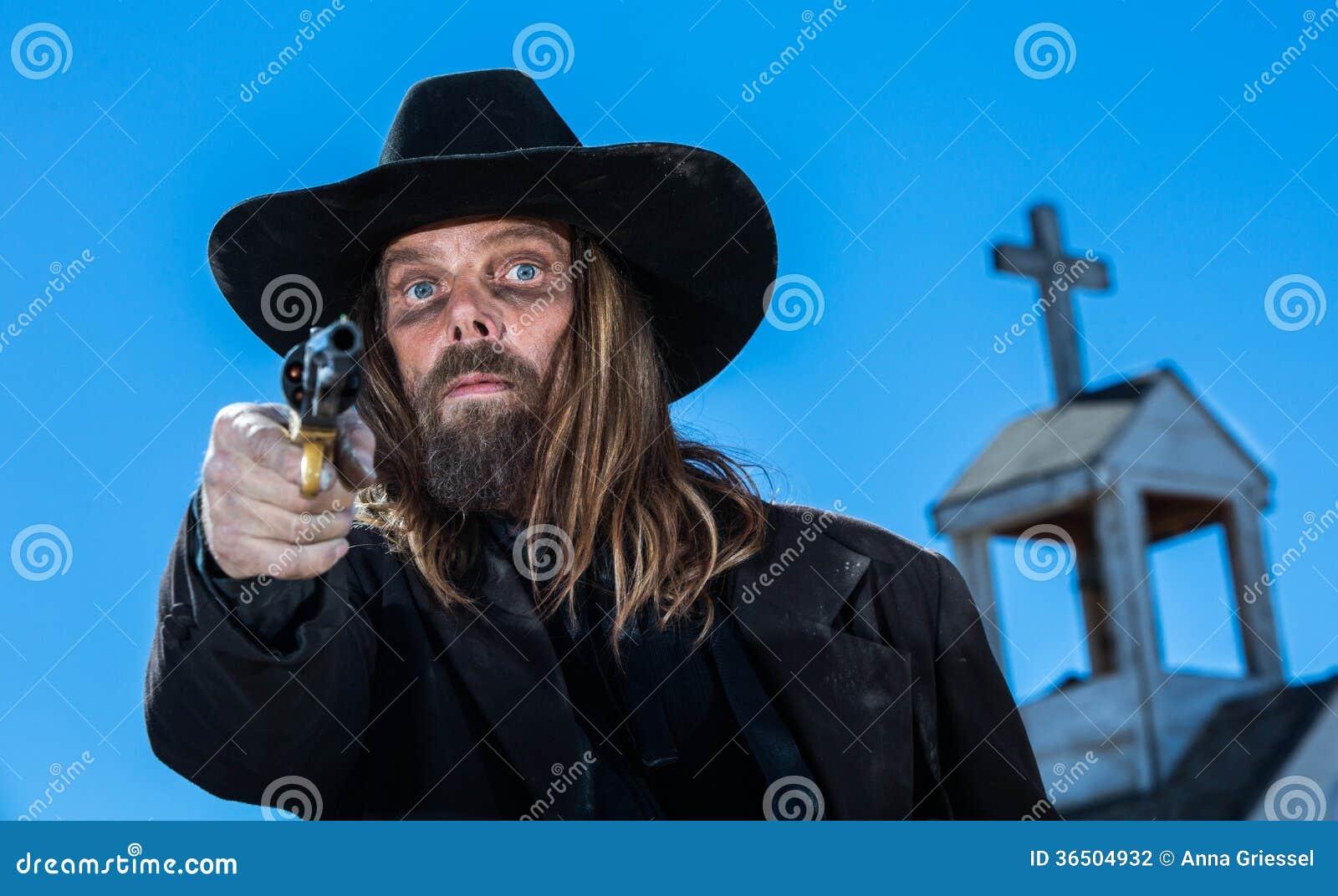 有枪的一位严肃的牛仔