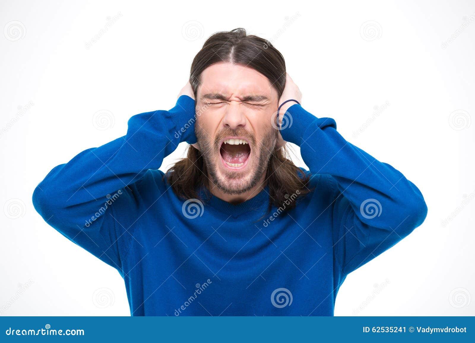 绝望人用人工和尖叫关闭了耳朵