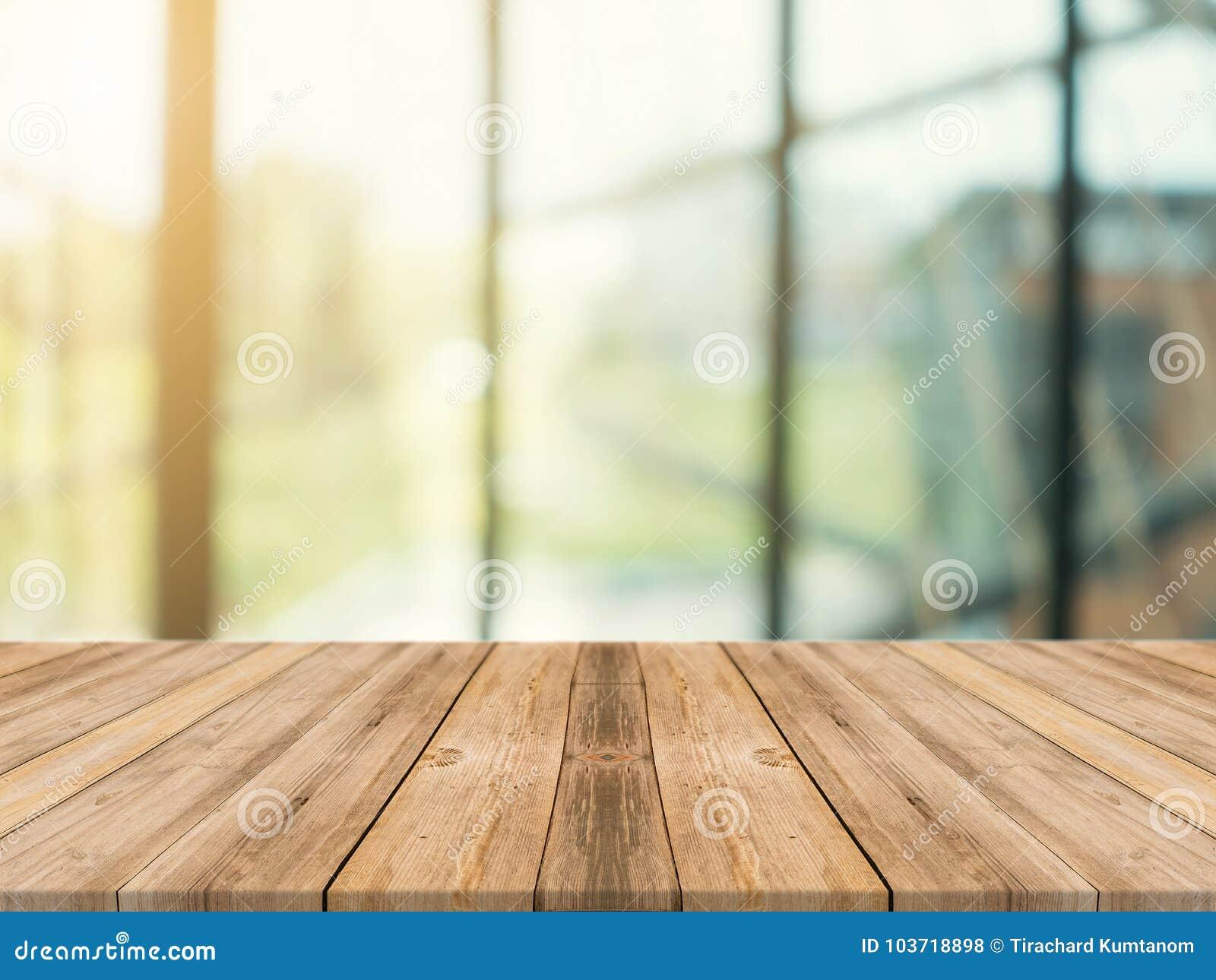 木板空的台式被弄脏的背景 在迷离的透视棕色木桌在咖啡店背景中