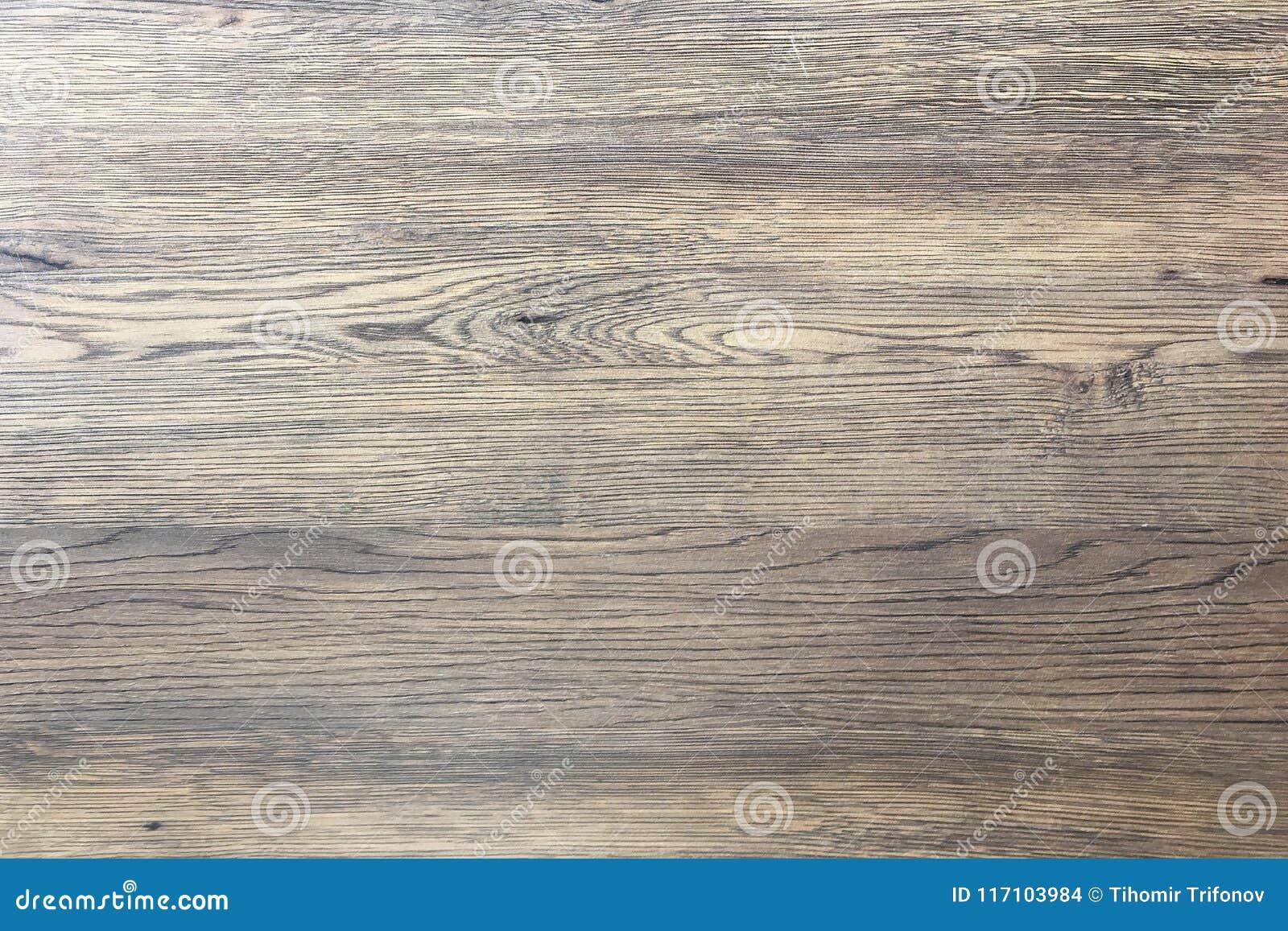 木纹理背景,点燃被风化的土气橡木 显示木纹纹理的退色的木被涂清漆的油漆 硬木