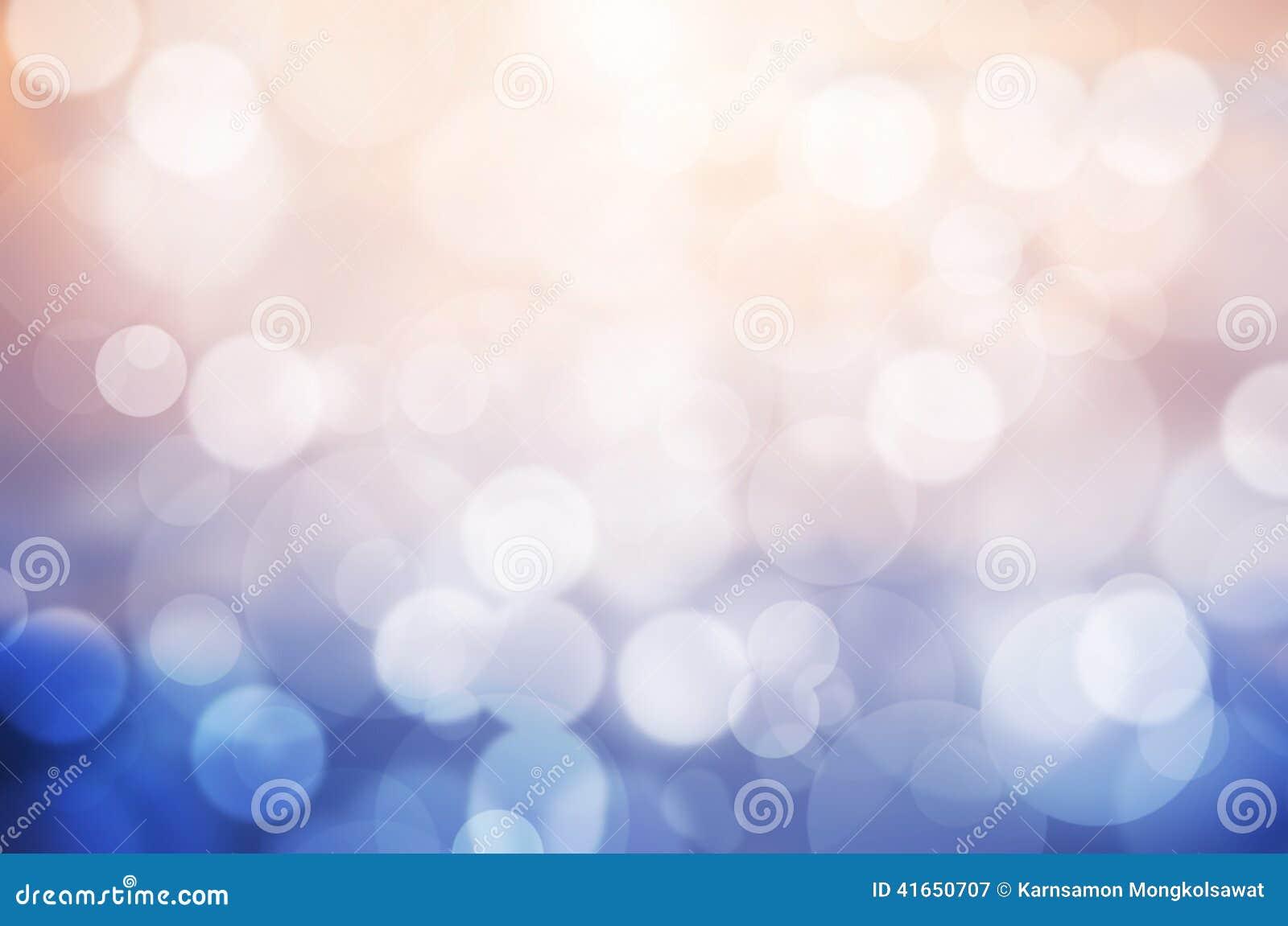 桃红色和蓝色bokeh背景的图象