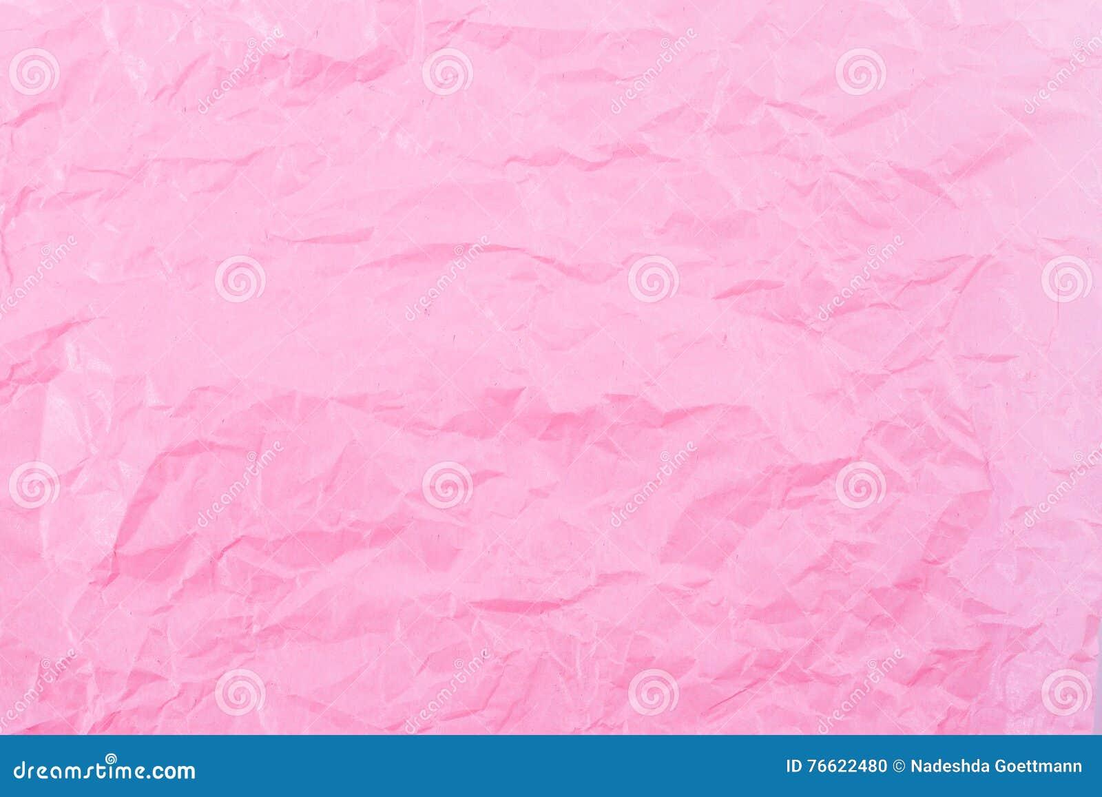 桃红色纸起皱纹的背景