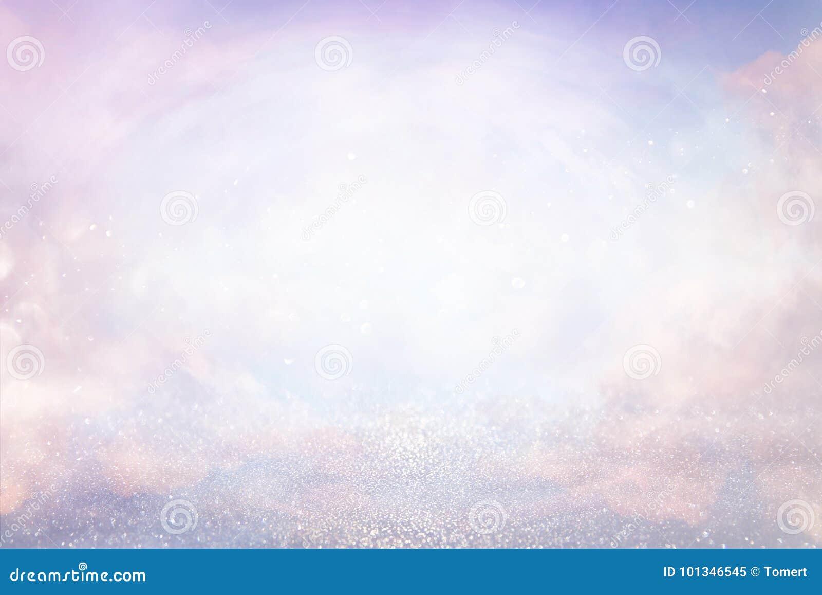 桃红色,浅紫色,桃红色和银色抽象bokeh光 defocused的背景