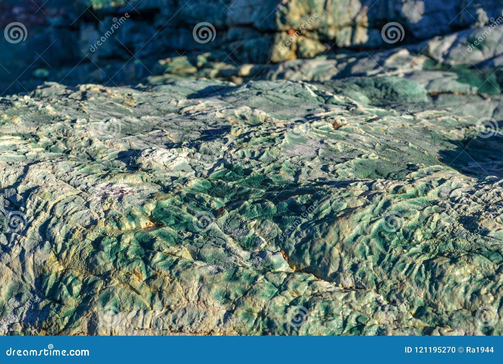 没有波浪的沿海A风平浪静 大冰砾 海的透明水 的adolphe