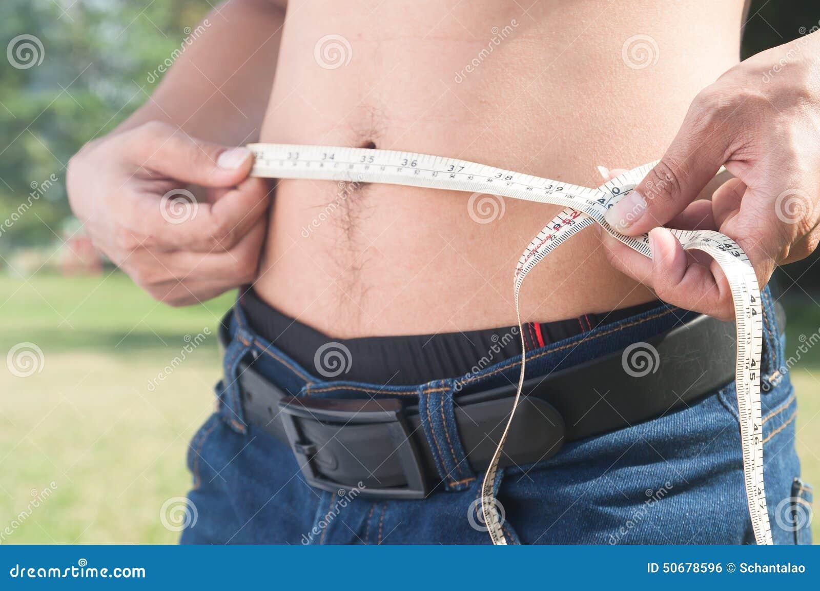 Download 测量他的身体的健康人 播种的和中央部位图象 库存照片. 图片 包括有 节食, 躯干, 正横, 评定, 播种 - 50678596