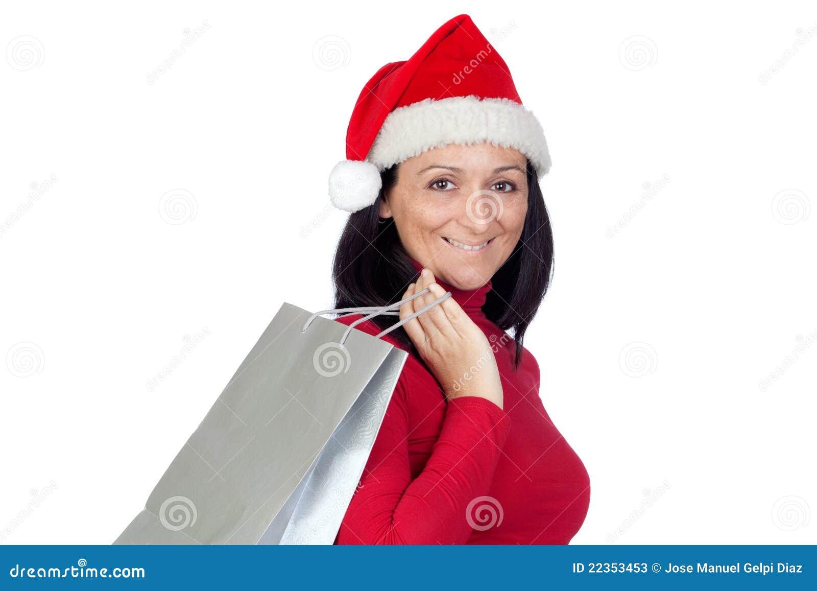 深色的圣诞节女孩去帽子购物