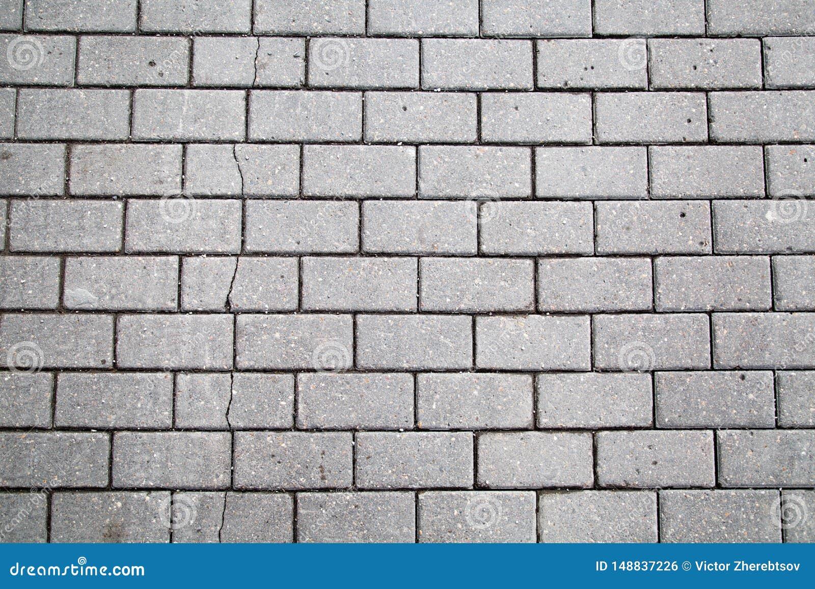 灰色人为与裂缝的摊铺机长方形形状背景