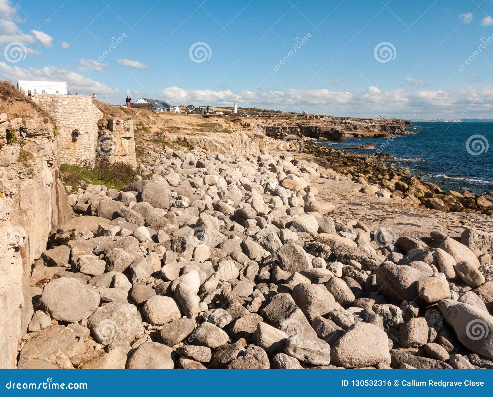 灰色岩石纹理在海岸海滩风景背景自然的