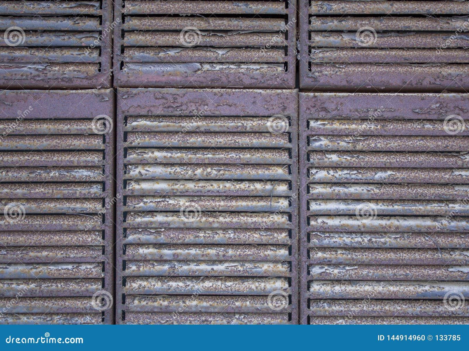 灰色棕色金属生锈的百叶窗格子特写镜头 E