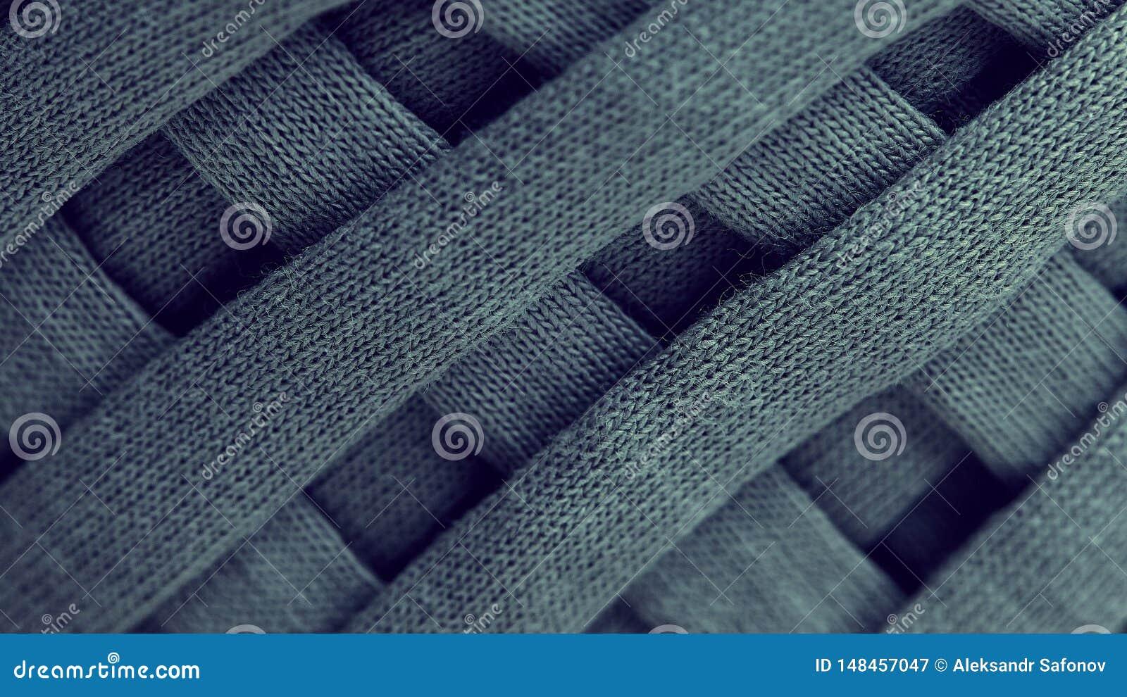 灰色被编织的毛线特写镜头丝球  宏观摄影背景纹理样式编织纤维织物 织品小条是