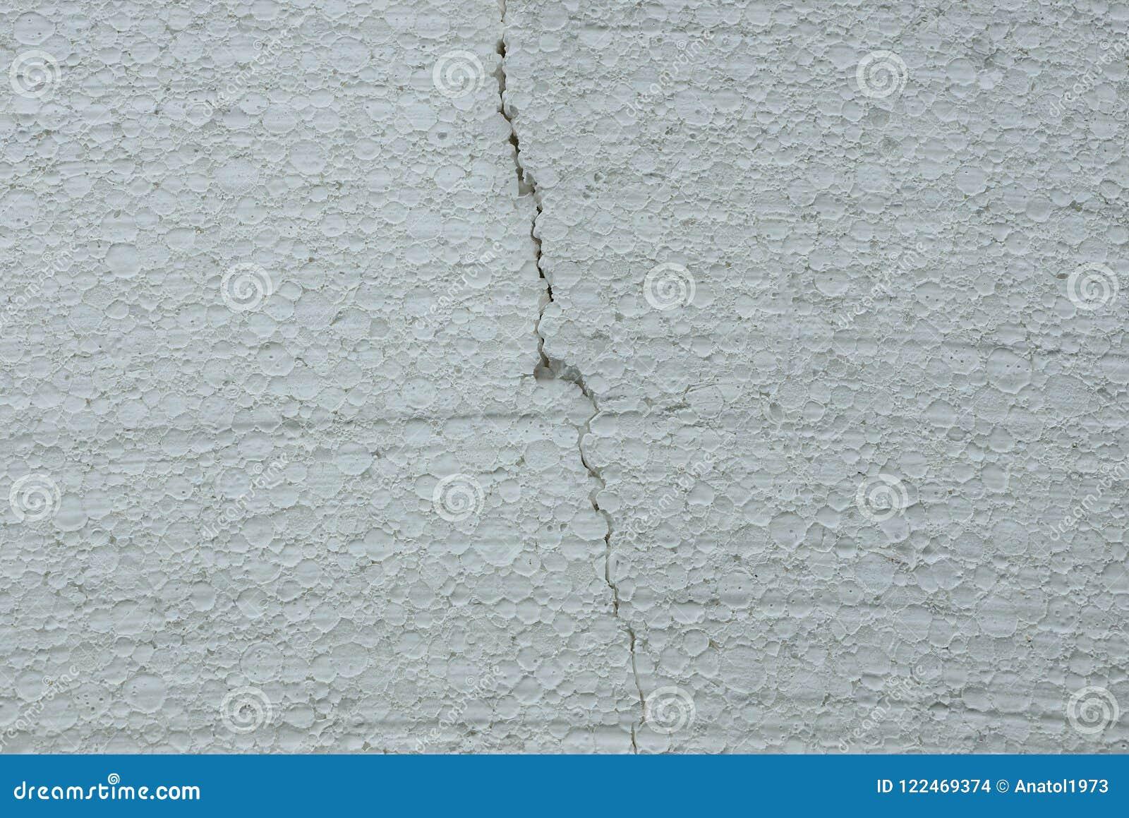 灰色裂缝多苯乙烯片断的白色塑料纹理