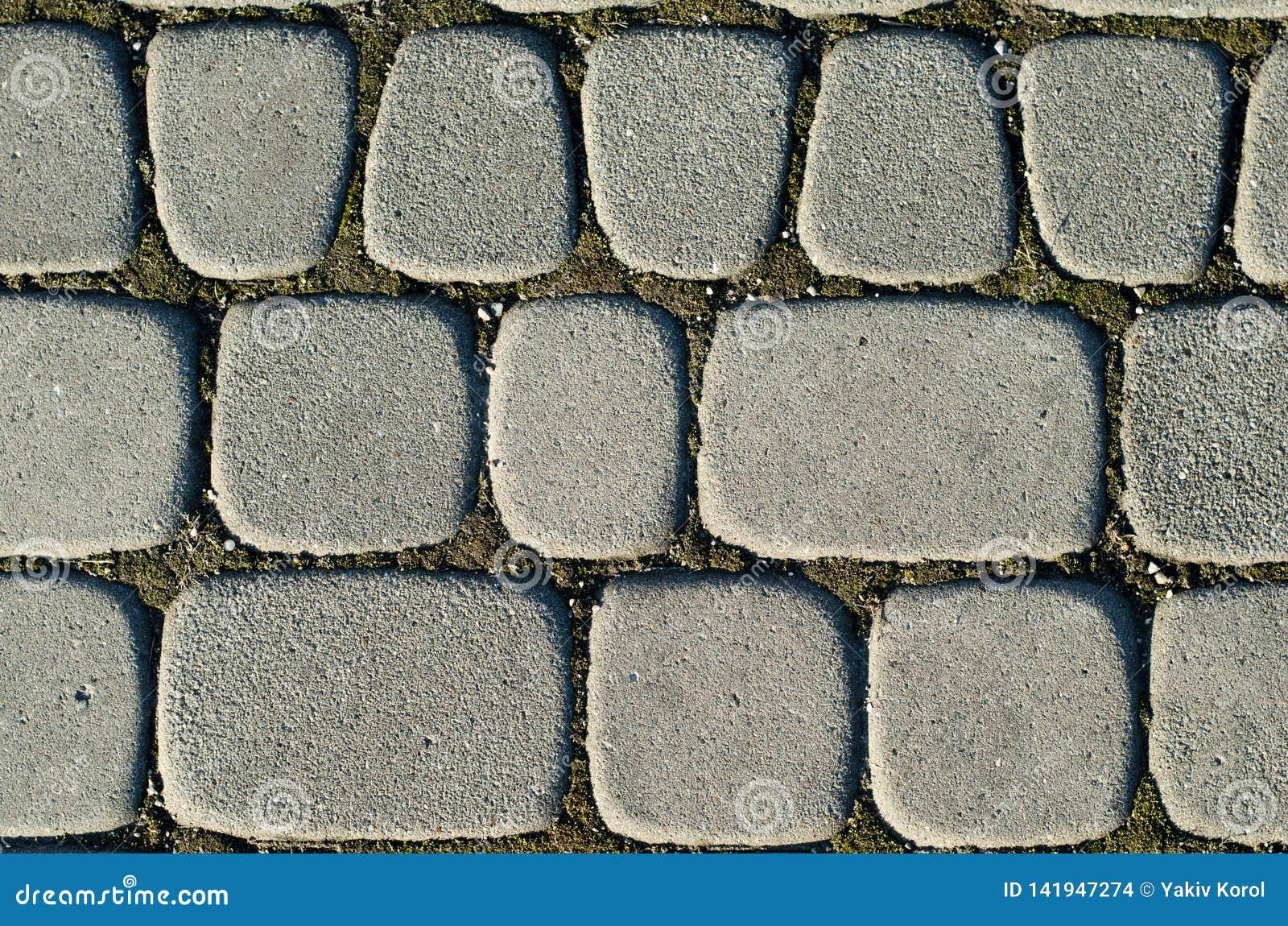 灰色颜色,另外大小不对称的铺路板  背景