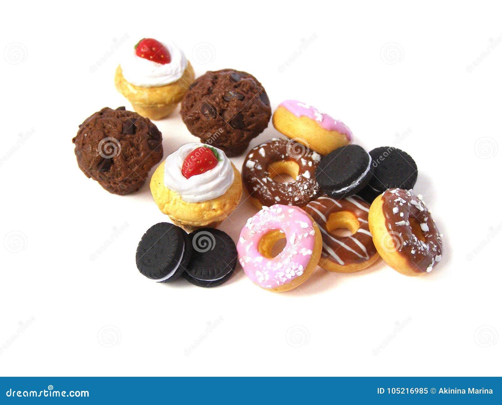 照片微型伪造品蛋糕和油炸圈饼