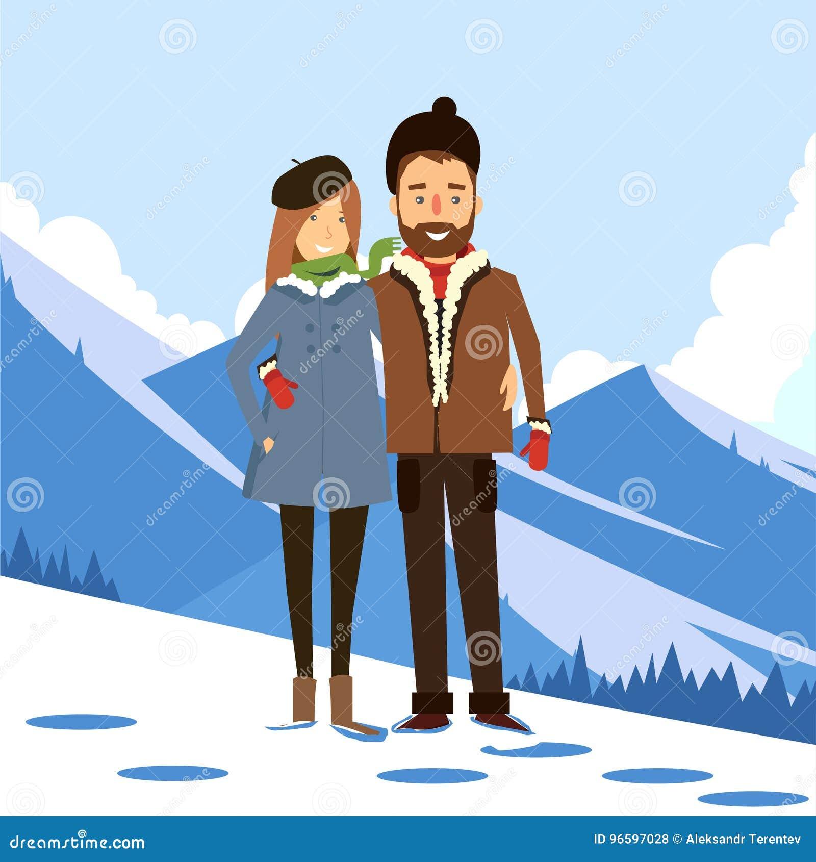爱恋的夫妇在多雪的山背景的冬天