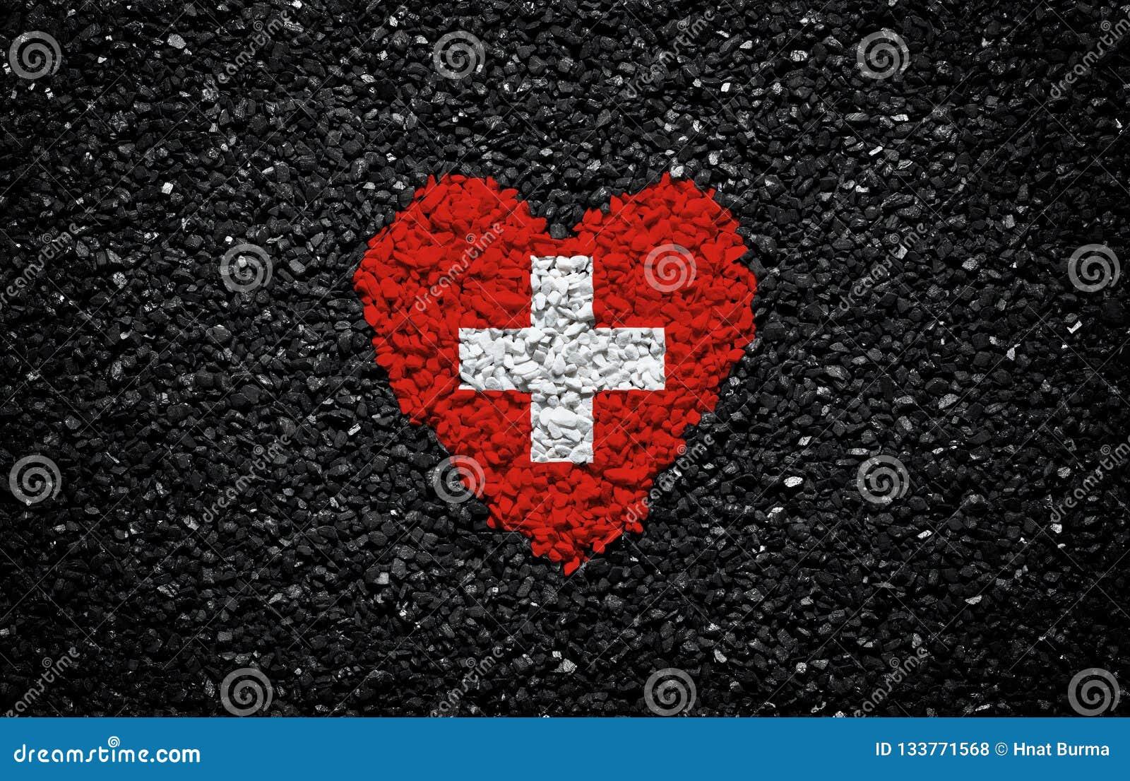 瑞士的旗子,瑞士旗子、心脏在黑背景,石头、石渣和木瓦,织地不很细墙壁