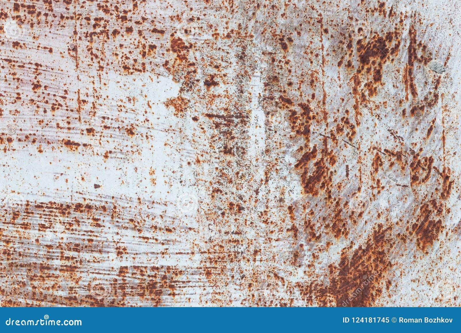 生锈的铁,老金属表面上的破裂的油漆,生锈的金属板料纹理与破裂和片状油漆,抽象生锈的