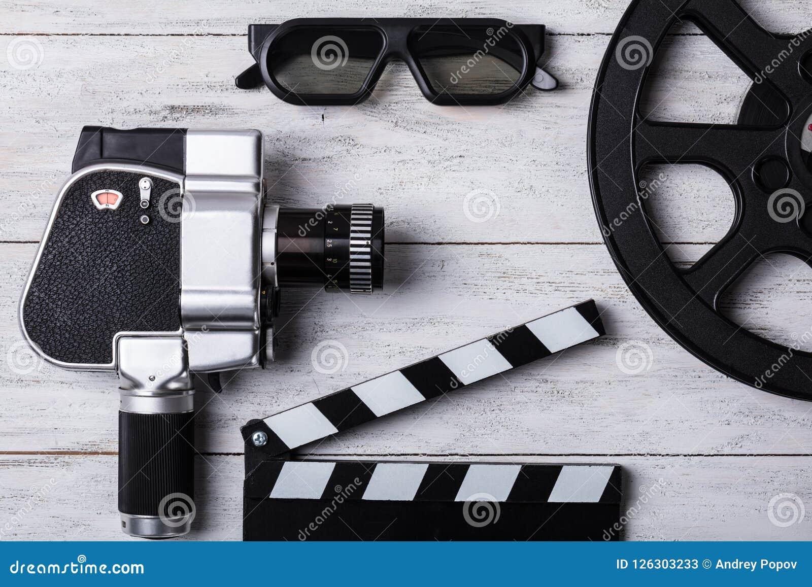 电影摄影机、影片轴和拍板高的看法