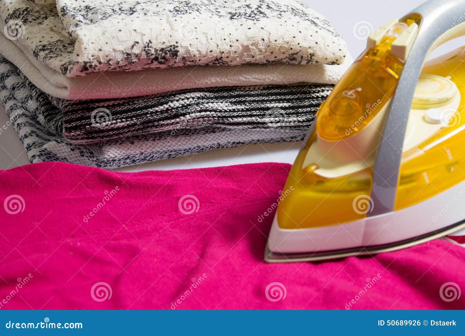 Download 电烙 库存照片. 图片 包括有 家事, 国内, 衣物, 五颜六色, 工作, 干净, 电烙, 空白, 布料 - 50689926