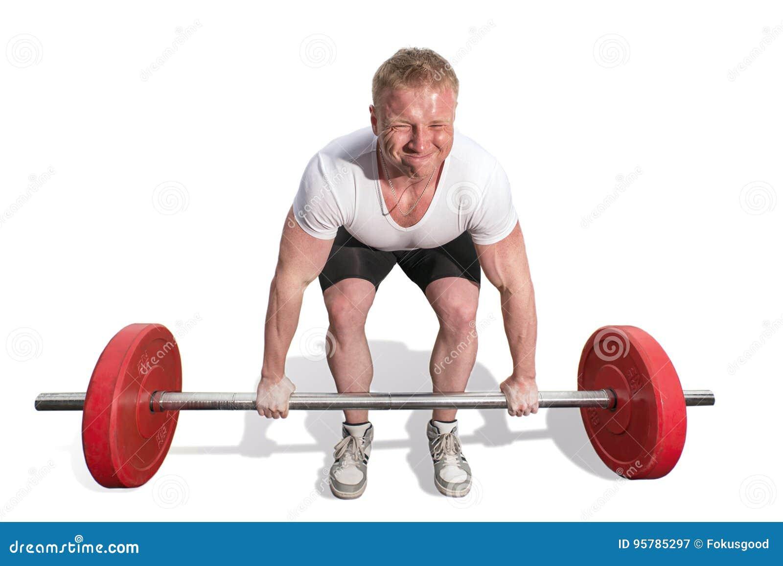 男性举重运动员坐下和培养酒吧
