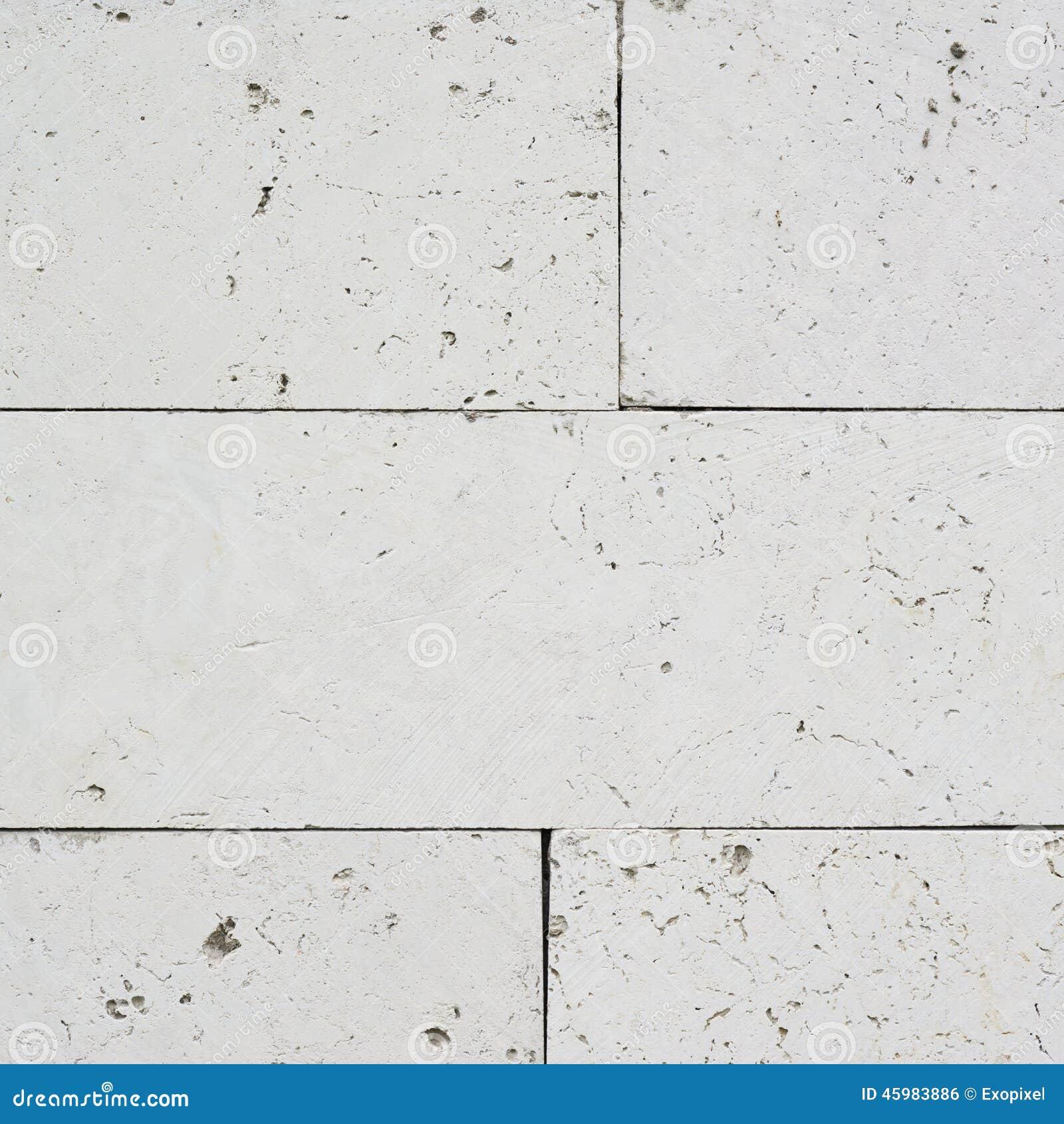 白色石灰石砖墙的片段