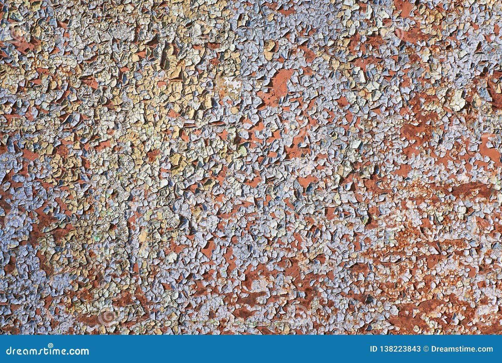 破裂的被绘的墙壁 老被剥皮的油漆背景