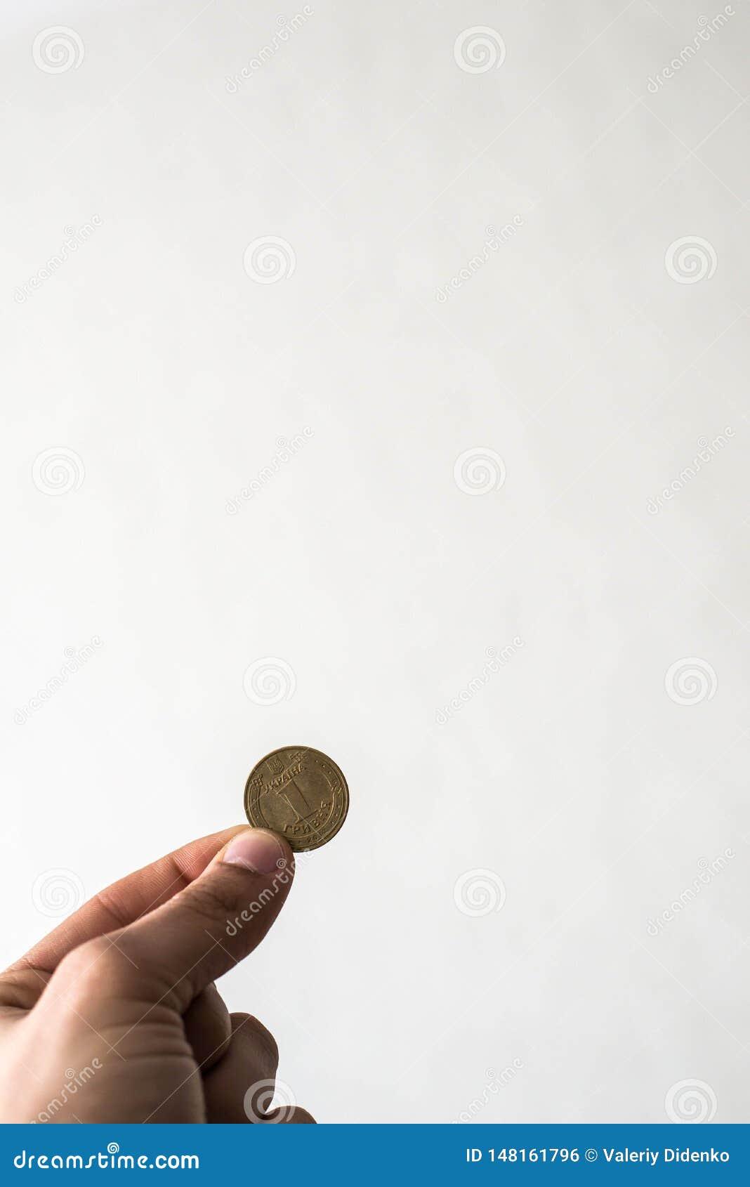 硬币在手中