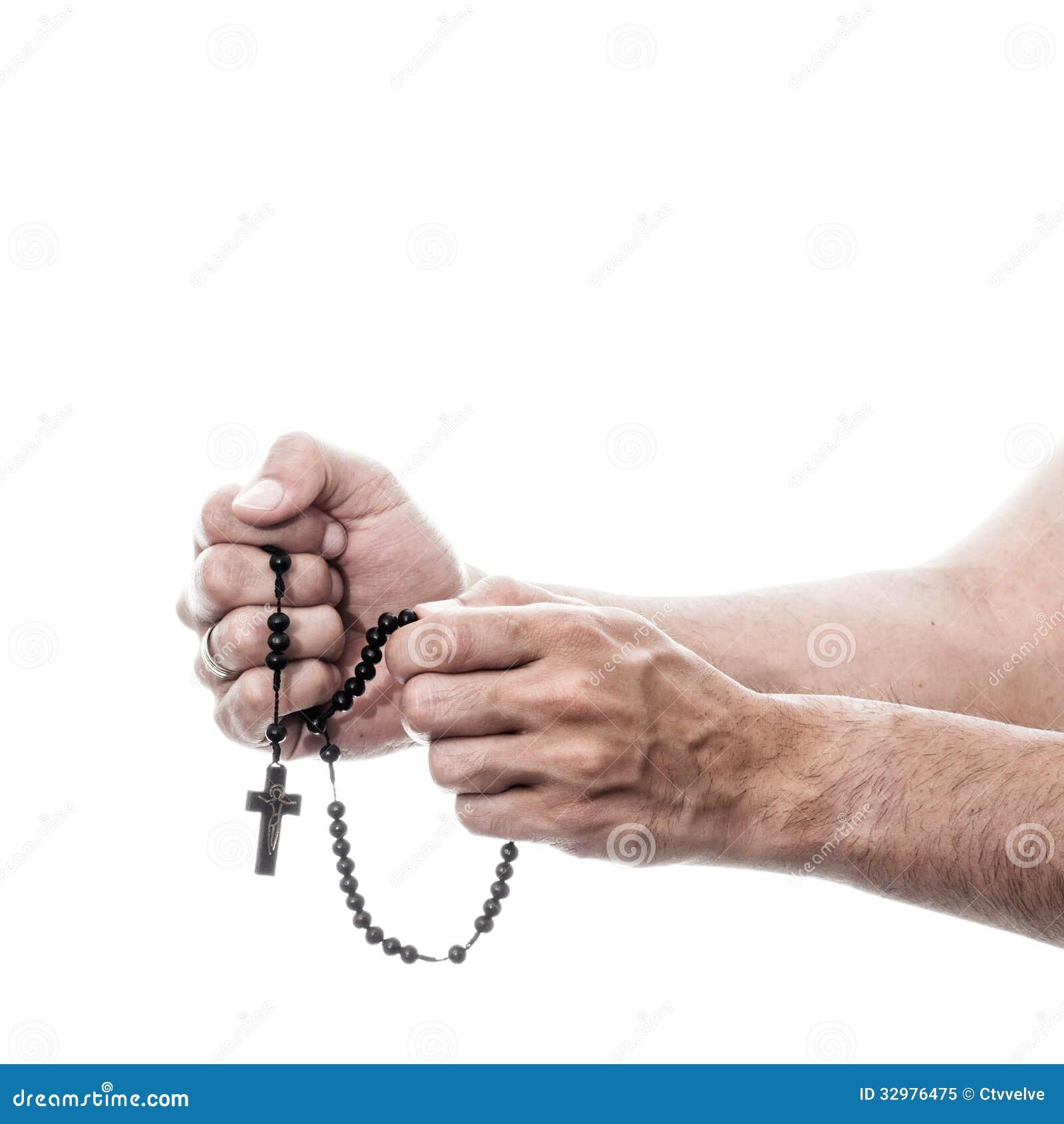 祈祷与念珠的男性手