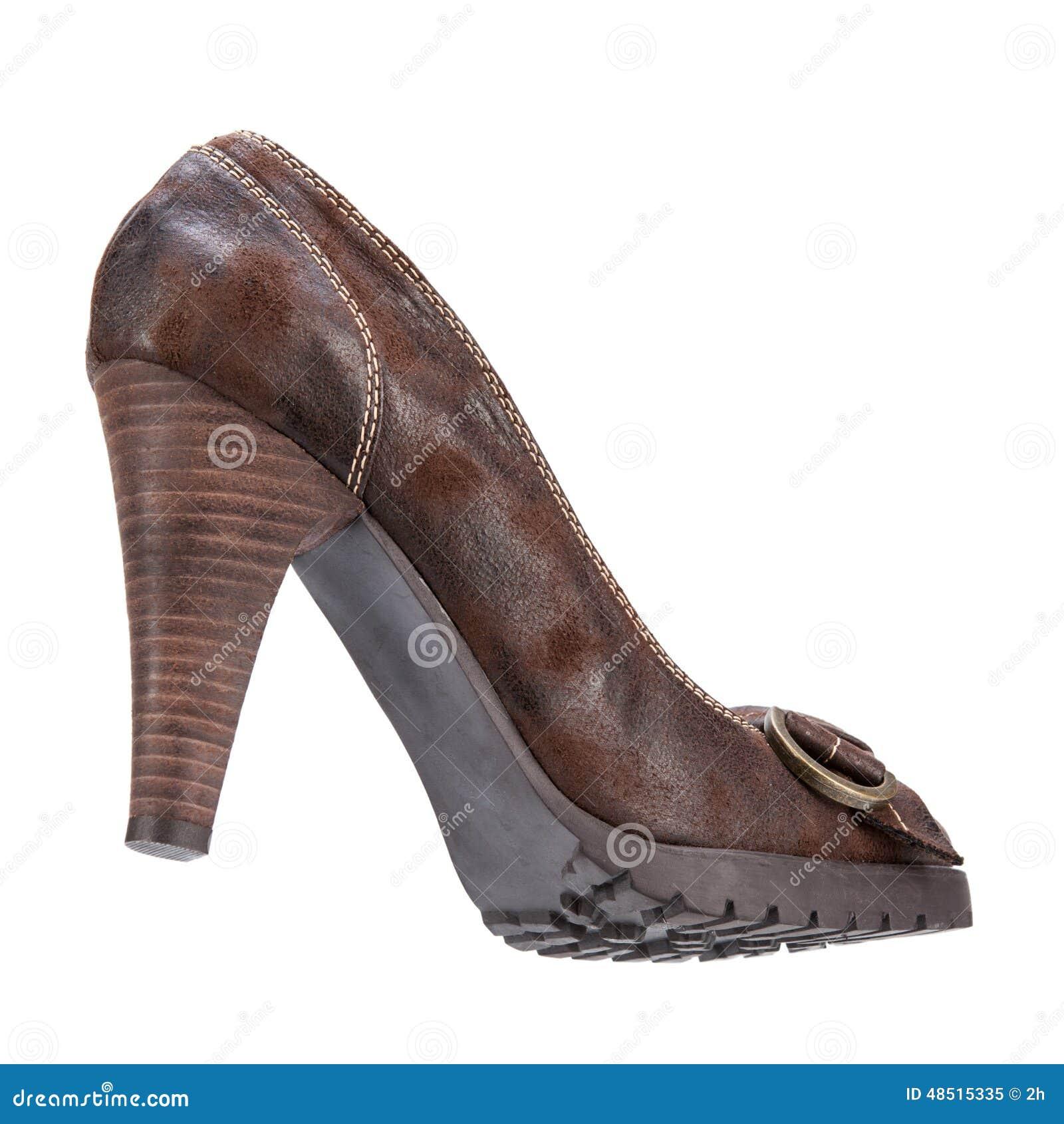 端庄的妇女的冬天在白色背景的演播室穿上鞋子射击.