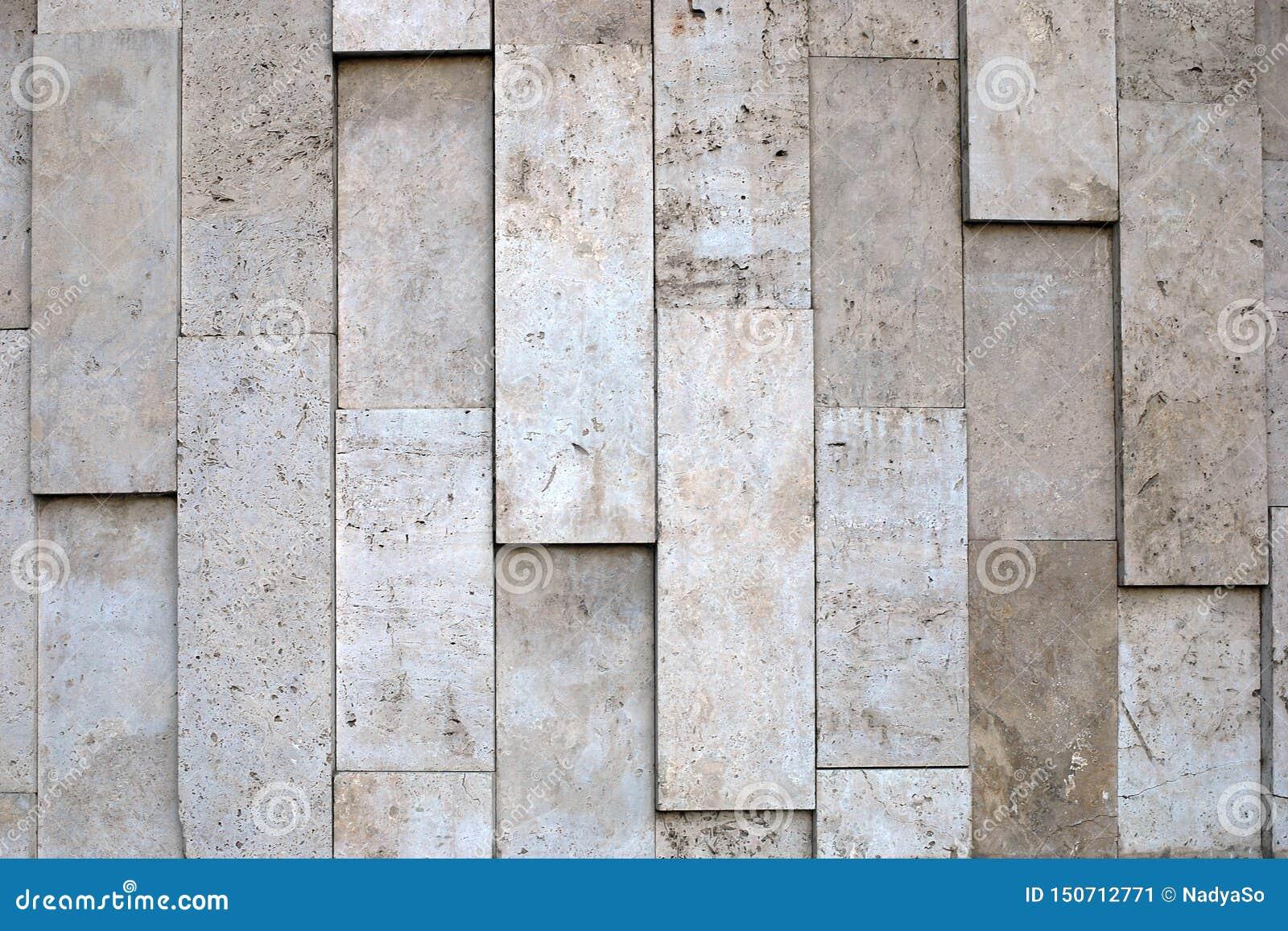 米黄标度颜色多孔材料自然参差不齐的石墙纹理
