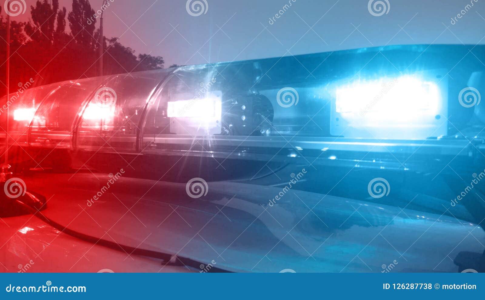 紧急车点燃闪动,检查城市,安全部门的警车