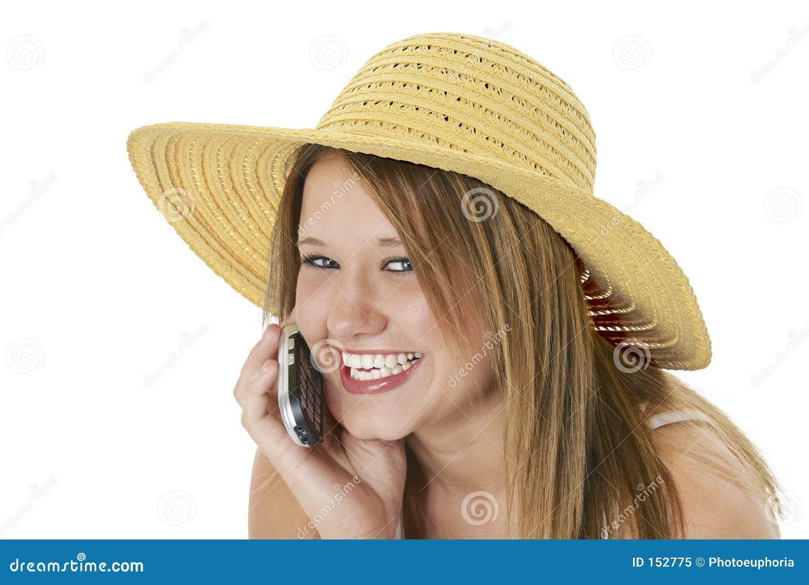 美丽的移动电话帽子青少年的黄色