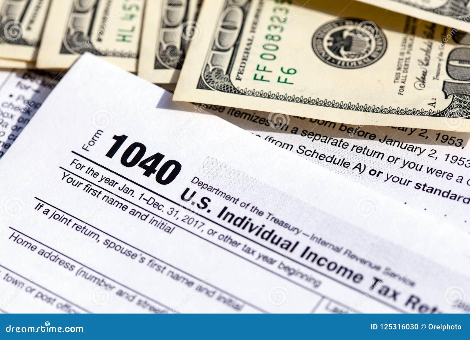 美国1040个体与一百元钞票的收入税单形式