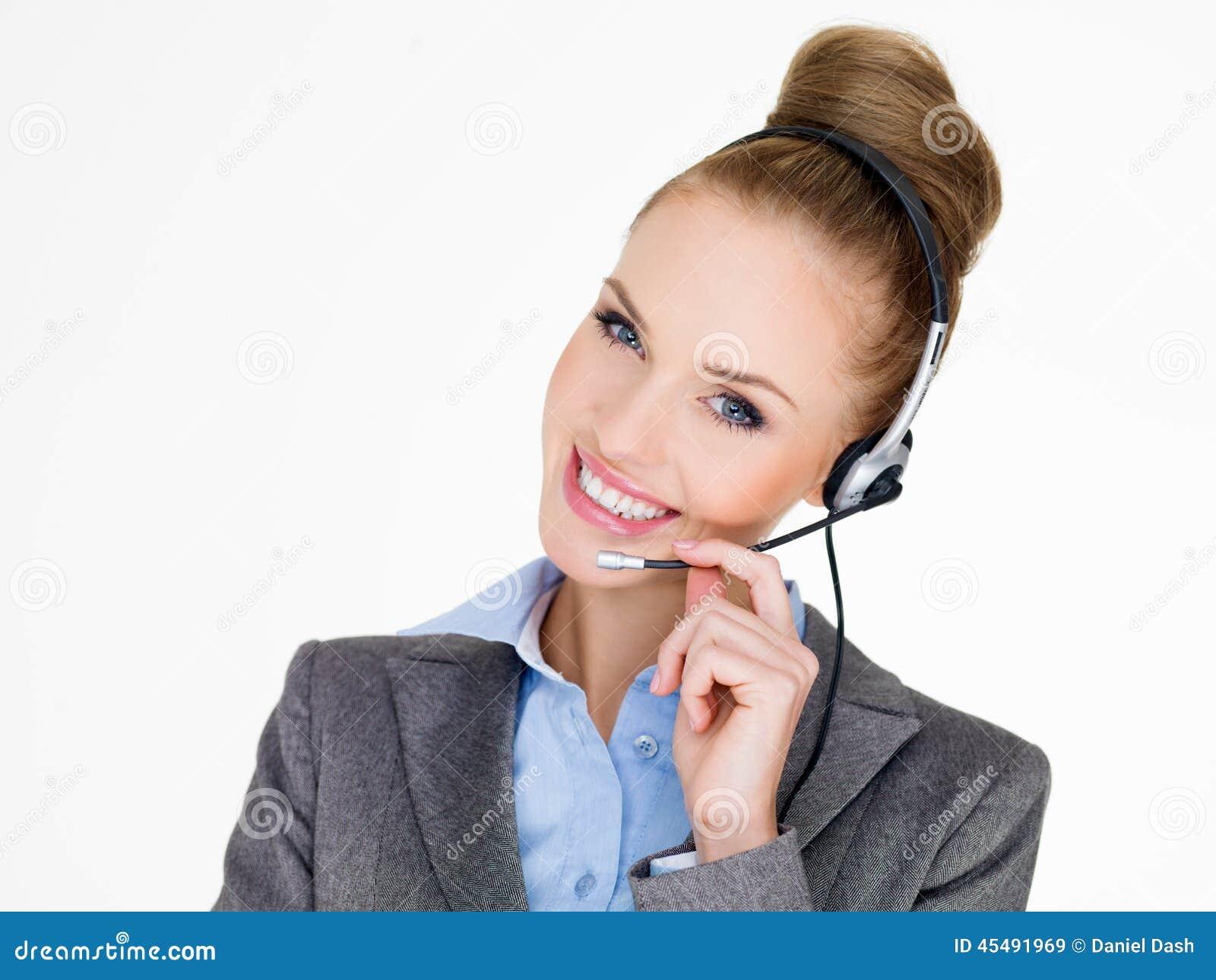 耳机的微笑的典雅的女实业家