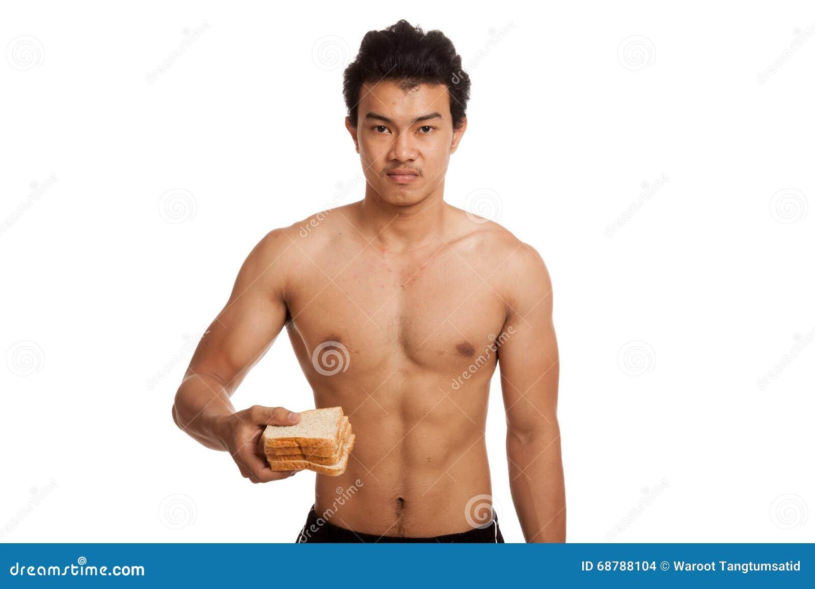 肌肉亚洲人装载气化器用一些面包