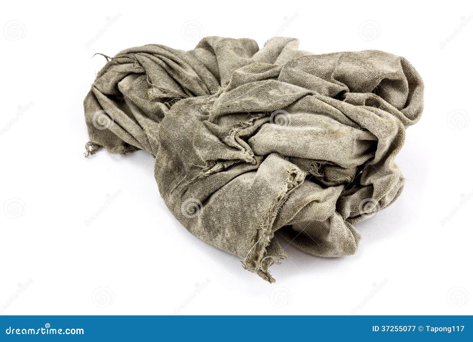在白色背景的肮脏的旧布.图片
