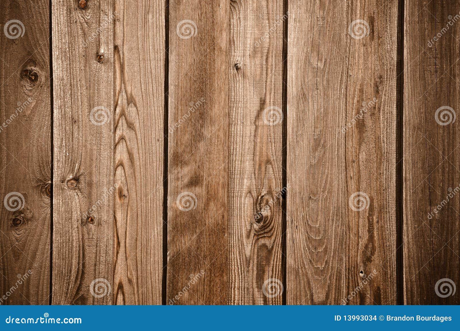 背景黑暗的甲板范围木头
