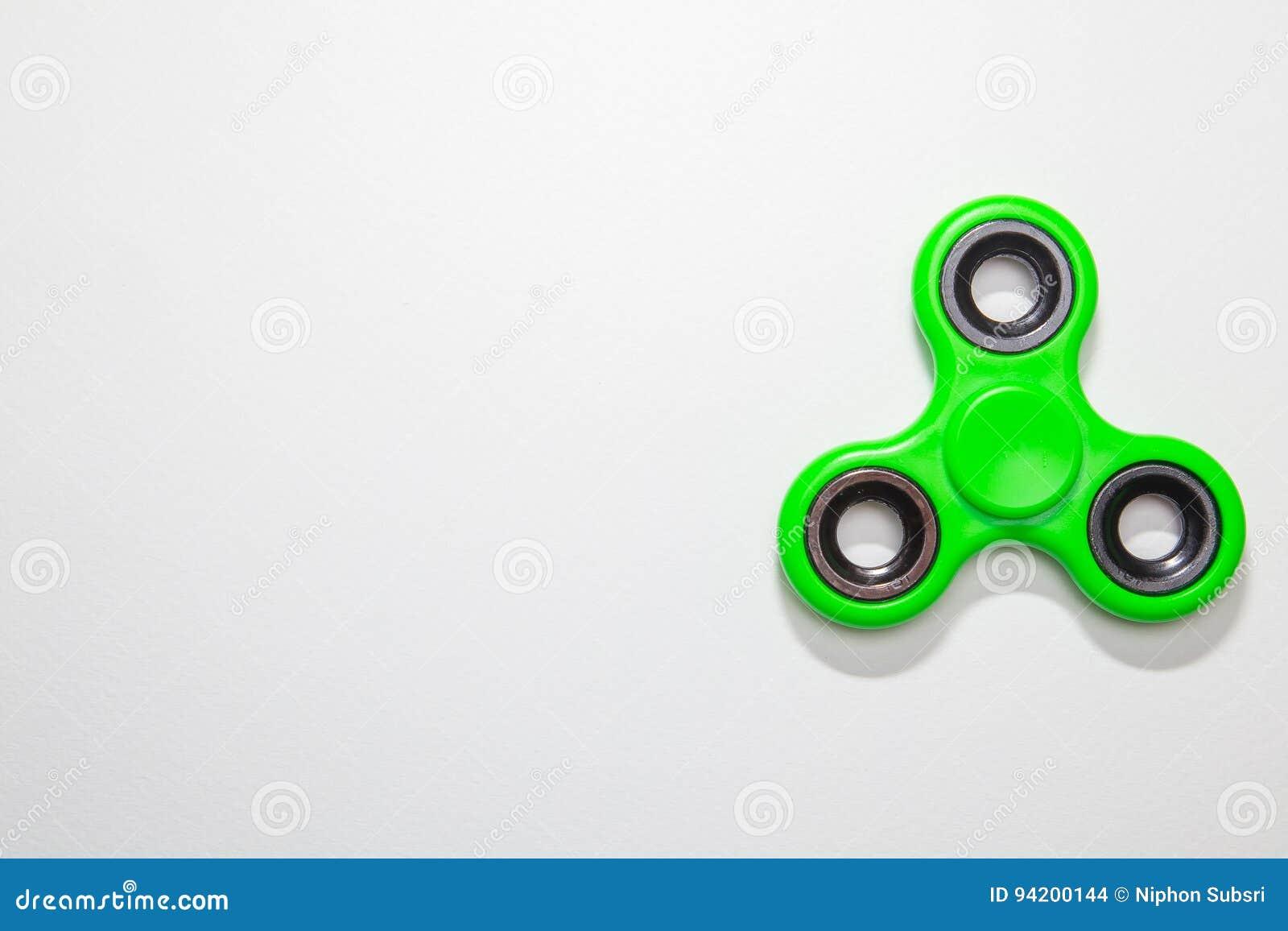 绿色坐立不安手指锭床工人玩具图象