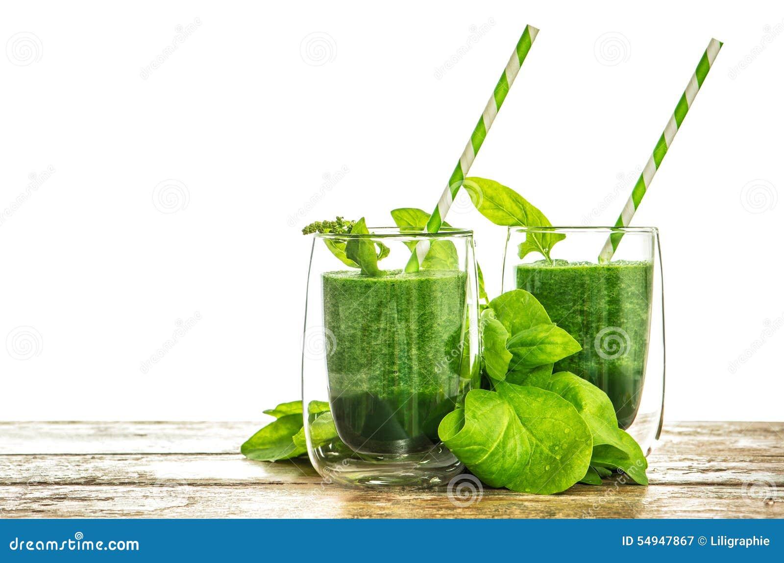 菠菜在透明玻璃把圆滑的人留在 健康绿色drin