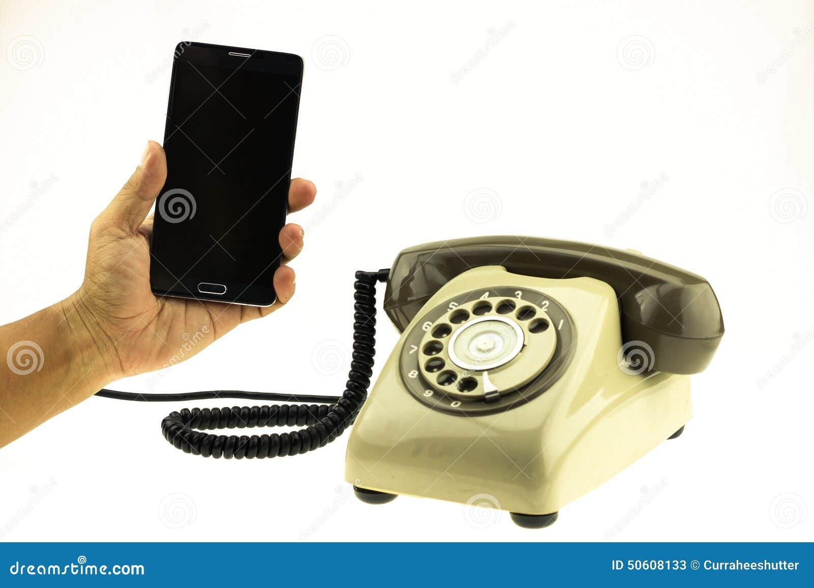 葡萄酒新的巧妙的电话图片样式有老电话的在白色背景 新的通讯技术