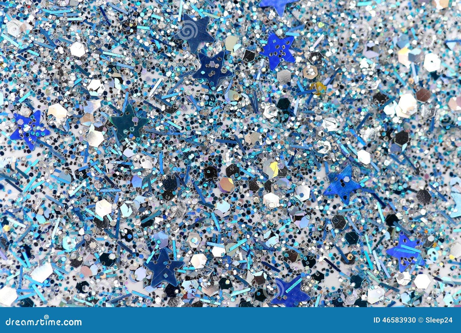 蓝色和银色结冰的雪冬天闪耀的星闪烁背景 假日,圣诞节,新年摘要纹理