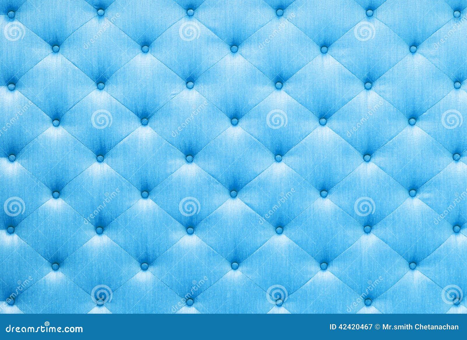關閉與按鈕的葡萄酒樣式藍色顏色沙發布料紋理.圖片