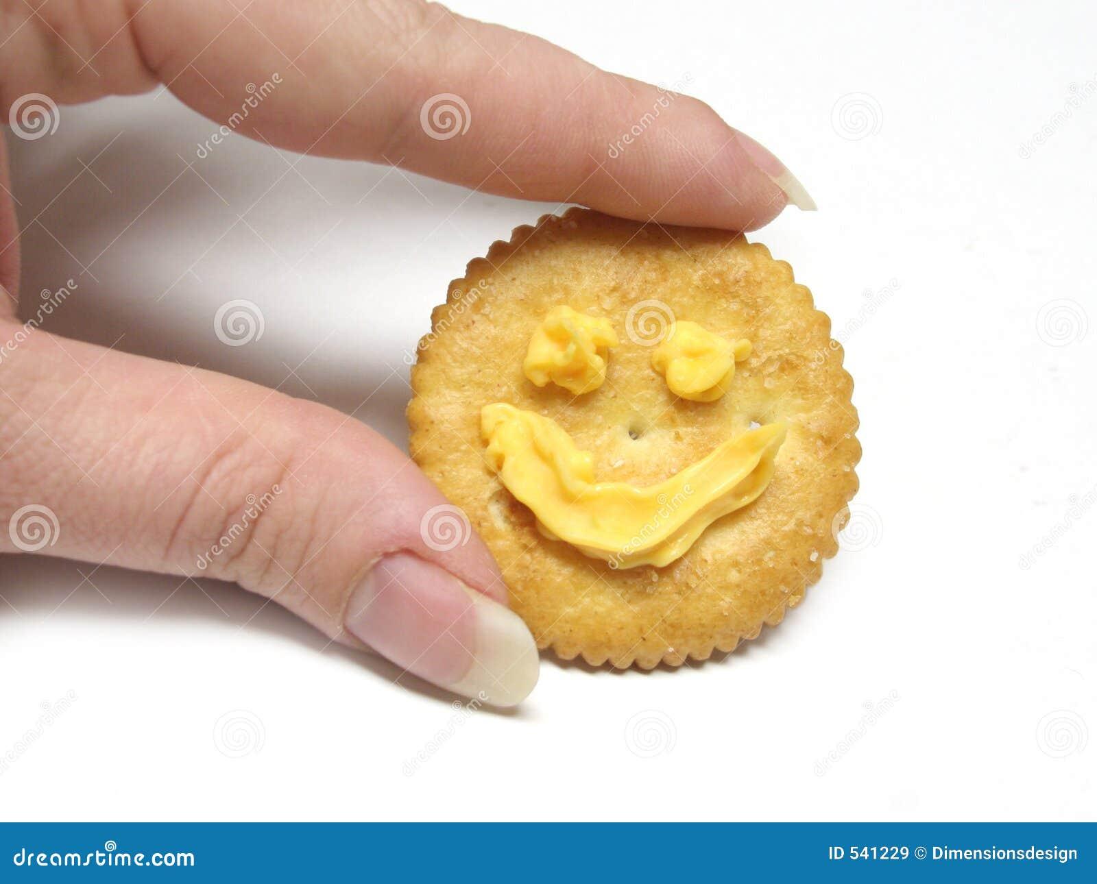 Download 薄脆饼干藏品微笑 库存图片. 图片 包括有 干酪, 表面, 薄脆饼干, 滋补, 淀粉, 孤立, 微笑, 钉子 - 541229