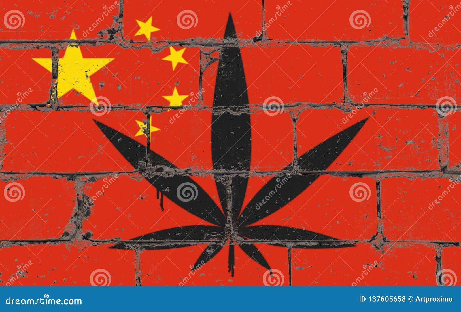 街道画街道艺术在钢板蜡纸的浪花图画 在砖墙上的大麻叶子有旗子的中国