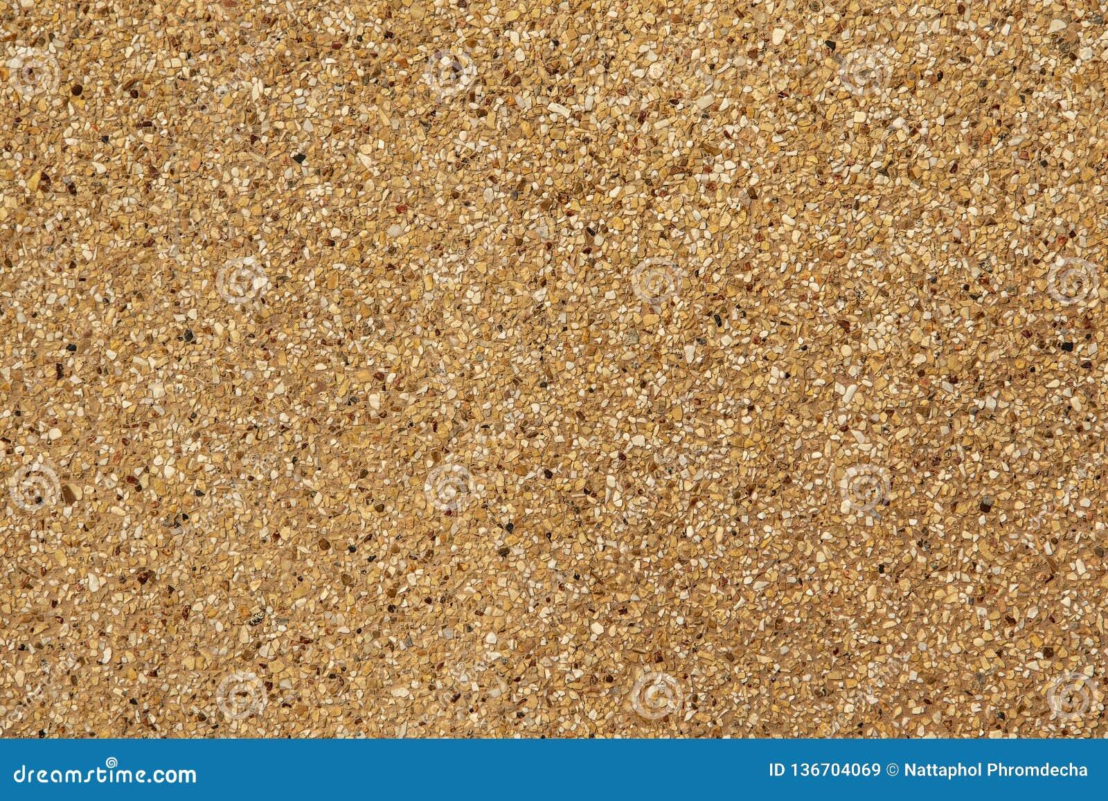 被暴露的聚集结束 被洗涤的沙子 纹理和背景