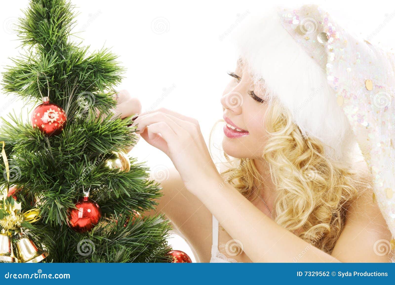 装饰女孩辅助工圣诞老人结构树的圣&#