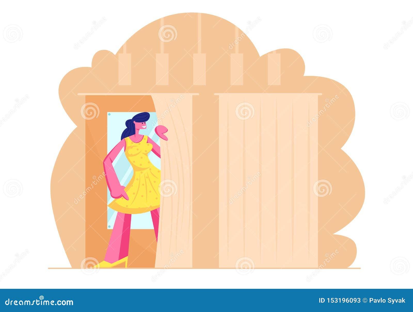 试穿的年轻女人在化装室关闭在商店,新的黄色礼服立场的女孩在与镜子的客舱在商店 ??