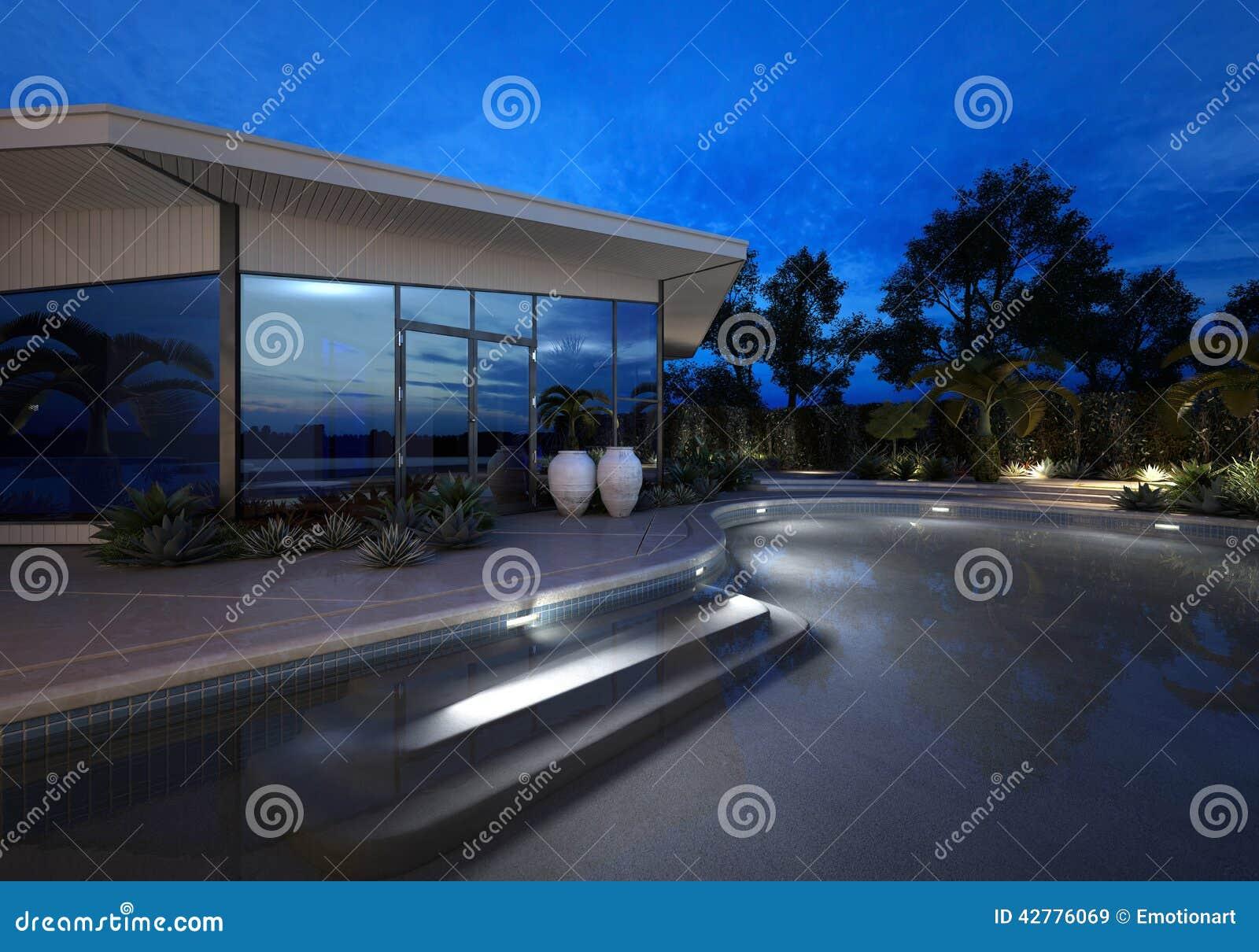 豪华别墅在与一个有启发性水池的晚上