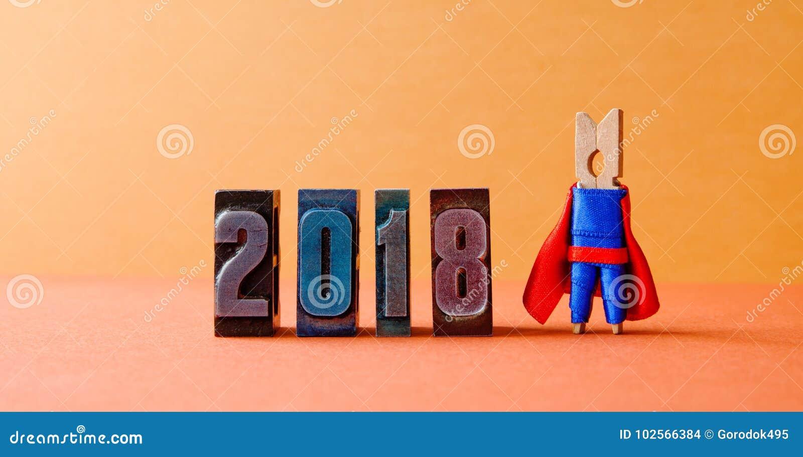 超级成功的2018新年卡片 摆在葡萄酒活版数字的勇敢的超级英雄领导 美丽的晒衣夹
